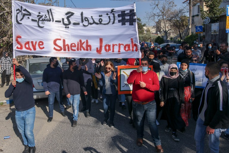 Palestinian, Israeli, and foreign activists demonstrate against Israeli occupation and settlement activity in the Palestinian territories [File: Ahmad Gharabli/AFP]