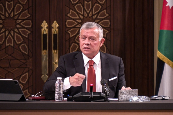 A handout picture released by the Jordanian Royal Palace on March 23, 2021 shows Jordanian King Abdullah II speaking during a meeting with the speaker and heads of a number of committees at the House of Representatives in the capital Amman [File: Jordanian Royal Palace/ AFP]
