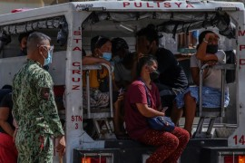 The Duterte government has responded to the pandemic in much the same way as it did to other national problems: a law-and-order crackdown with heavy policing [Jam Sta Rosa/AFP]