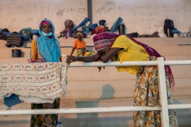 Displaced people from Palma gather in the Pemba sports centre to receive humanitarian aid [Alfredo Zuniga/AFP]