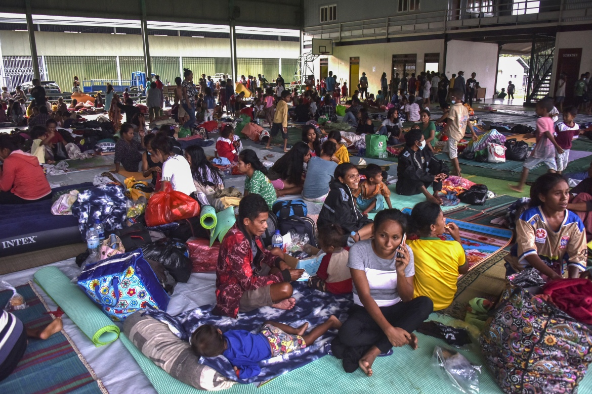Residents take refuge at an evacuation centre after fleeing their damaged homes in Dili, East Timor, as torrential rains triggered floods and landslides in Indonesia and East Timor. [Valentino Dariel Sousa/AFP]