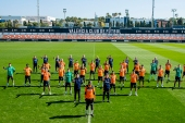 The Valencia squad lined up behind Diakhaby at their training ground in a public display of support [Valencia/Lazaro Dela Pena/AFP]