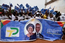Supporters wave flags to welcome Benin President Patrice Talon and running mate Mariam Talata to a campaign rally at Abomey-Calavi, Benin, on April 9, 2021 [Pius Utomi Ekpei/ AFP]