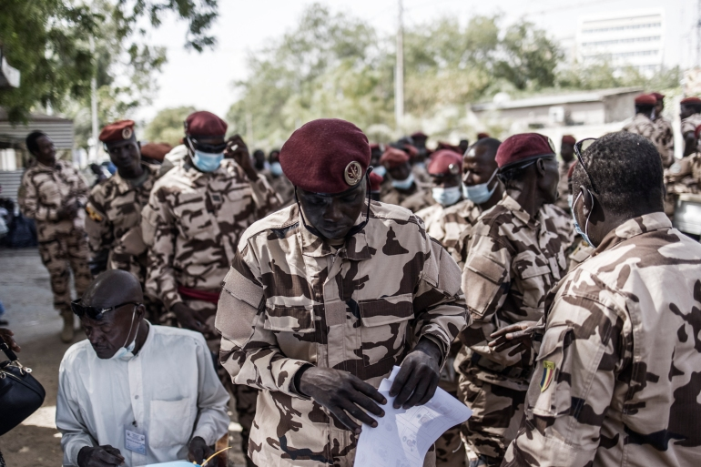 Chadian soldiers belonging to the Presidential Guard vote during an early round of the election on April 10 [Marco Longari/AFP]