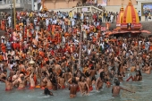 Hindus take a dip in the Ganges river on Monday during the ongoing Kumbh Mela festival in Haridwar [Money Sharma/AFP]