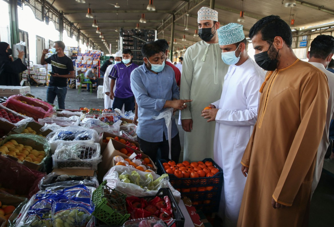 Omanis buy fresh food at the Mawaleh market in the capital Muscat ahead of the Muslim fasting month of Ramadan. [Mohammed Mahjoub/AFP]