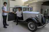 Galle Face Hotel chairman Sanjeev Gardiner, right, and his son Seshaan pose with the 1935 Standard Nine vintage car [Ishara S Kodikara/AFP]