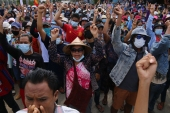 This handout photo taken and released by Dawei Watch on April 15, 2021 shows protesters taking part in a demonstration against the military coup in Dawei's Launglone township [Handout/ Dawei Watch via AFP]