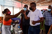 Prime Minister of Cape Verde Ulisses Correia e Silva interacts with vendors at the Plateau market in Praia, after his victory in the 2021 parliamentary elections [Seyllou/AFP]