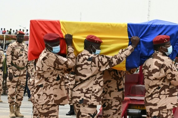 Chad army officers carry the coffin of late Chadian President Idriss Deby [File: Issouf Sanogo/AFP]