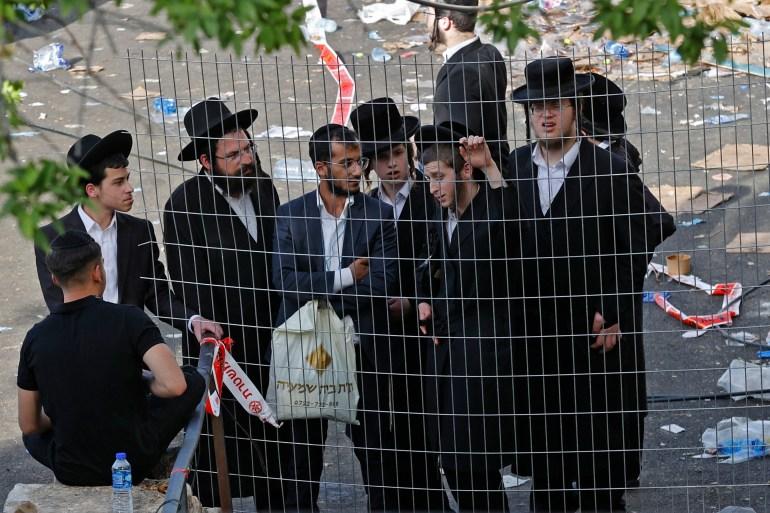 A polícia israelense persegue rotineiramente indivíduos da comunidade ortodoxa que se esquivam do serviço militar e tentam recrutá-los [File: Jack Guez/AFP]