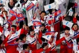 Athletes from North Korea and South Korea march together during the closing ceremony of the 2018 Winter Games in Pyeongchang [File: Murad Sezer/Reuters]