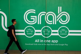 Singapore-based Grab is set to list in the US at a valuation of almost $40bn in the world's largest SPAC merger [File: Edgar Su/Reuters]