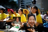 Students hold portraits of deceased former South Korean 'comfort women' during a weekly anti-Japan rally in Seoul, South Korea, August 15, 2018 [File: Kim Hong-Ji/ Reuters]