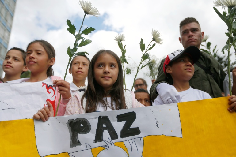 People take part in a rally against violence, following a car bomb explosion, in Bogota, Colombia, on January 20, 2019 [File: Luisa Gonzalez/Reuters]