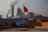 China - the world's top carbon emitter - has promised to reach peak emissions by 2030 and become carbon neutral by 2060 [File: Thomas Peter/Reuters]