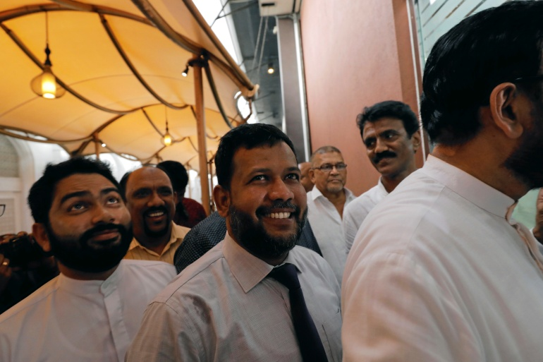 Bathiudeen (center), leader of the All Ceylon Makkal Party, was taken into custody on Saturday under the Prevention of Terrorism Act [File: Dinuka Liyanawatte/Reuters]