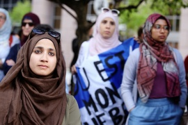 Women protest against Quebec's Bill 21, which bans teachers, police, government lawyers and others in positions of authority from wearing religious symbols on the job [File: Christinne Muschi/Reuters]