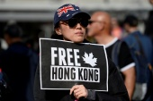 Supporters hold a rally in solidarity with Hong Kong protesters, in Vancouver, British Columbia, in September 2019 [File: Jennifer Gauthier/Reuters]