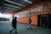 Alibaba said in a statement posted on its official Weibo account that it 'accepted' the decision and would resolutely implement the rulings imposed by regulators [File: Aly Song/Reuters]