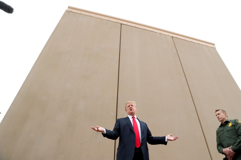 Former US President Donald Trump during a tour of US-Mexico border wall prototypes near the Otay Mesa Port of Entry in San Diego, California [File: Kevin Lamarque/Reuters]