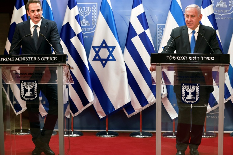 Israeli Prime Minister Benjamin Netanyahu attends a news conference with Greek Prime Minister Kyriakos Mitsotakis after their meeting in the PM's office in Jerusalem [File: Menahem Kahana/Pool/Reuters]