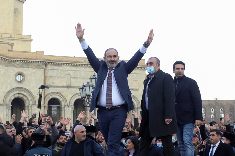 Armenian Prime Minister Nikol Pashinyan greets his supporters during a gathering in Republic Square in Yerevan, Armenia, February 25, 2021 [Stepan Poghosyan/Photolure via Reuters]