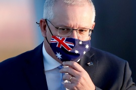Morrison says it is 'highly unlikely' travellers from India would face the penalties amid pressure to overturn them [File: Issei Kato/Reuters]