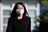 Huawei Technologies Chief Financial Officer Meng Wanzhou leaves her home to attend a court hearing in Vancouver, British Columbia, on March 29 [Jennifer Gauthier/Reuters]