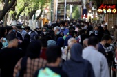 Iran has reported more than two million cases sine the start of the pandemic, including 64,232 deaths [Majid Asgaripour/WANA/Reuters]