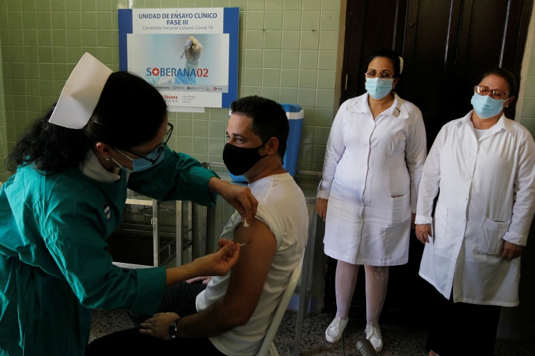 A volunteer receives a dose of the Soberana-02 COVID-19 vaccine in Havana [Jorge Luis Banos/Reuters]