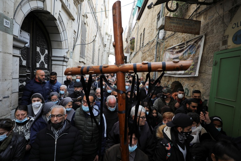 Christian worshippers take part in a Good Friday procession along the Via Dolorosa amid eased coronavirus restrictions, during Easter Holy Week in Jerusalem's Old City [Ammar Awad/Reuters]