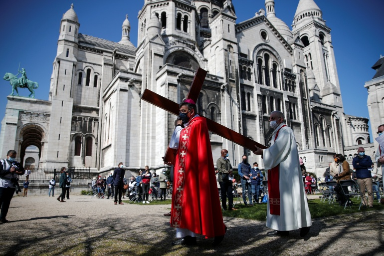 Archbishop of Paris Michel Aupetit leads the annual procession of the Stations of the Cross on Good Friday at the Sacre-Coeur Basilica of Montmartre in Paris, France [Benoit Tessier/Reuters]
