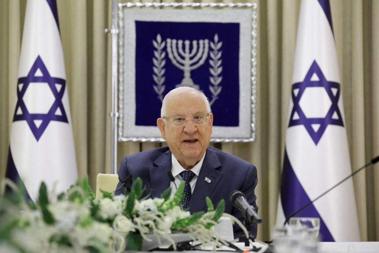 Israeli President Reuven Rivlin speaks during consultations with party representatives on Tuesday [Amir Cohen/Reuters]