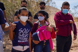 Asylum-seeking migrants crossing the border from Mexico were detained by US border patrol agents in Calexico, California on April 8 [Allison Dinner/Reuters]
