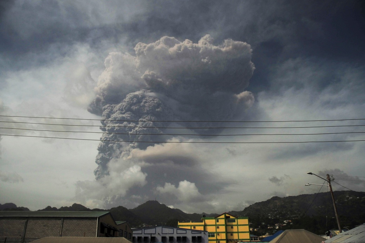 Ash and smoke billow as the La Soufriere volcano erupts in Kingstown on the eastern Caribbean island of St Vincent. [Robertson S. Henry/Reuters]