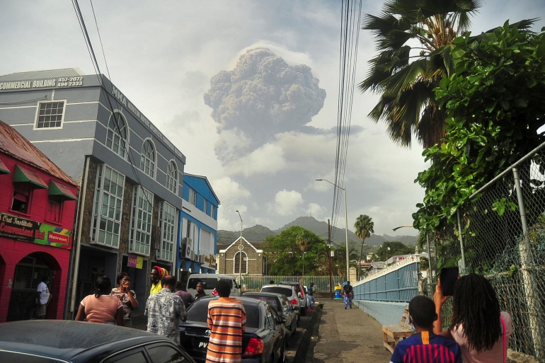 Ash and smoke billow as the La Soufriere volcano erupts in Kingstown on the eastern Caribbean island of Saint Vincent [Robertson S. Henry/Reuters]