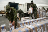 Soldiers unload electoral materials to be distributed ahead of the second round of presidential elections, in Quito, Ecuador, on April 10 [Luisa Gonzalez/Reuters]