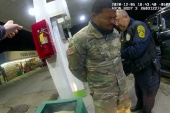 US Army 2nd Lieutenant Caron Nazario reacts while handcuffed after being sprayed with a chemical agent by Windsor police officer Joe Gutierrez at a gas station during a traffic stop. [Handout/Windsor Police via Reuters]
