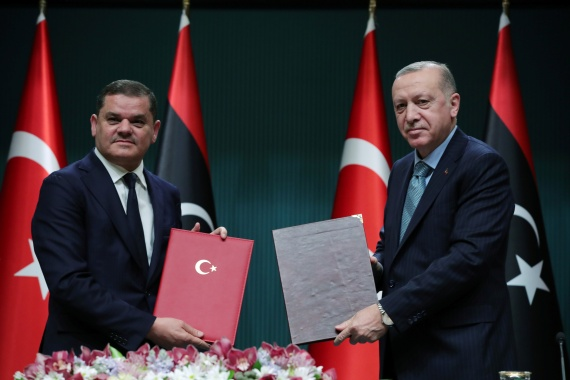 Turkish President Recep Tayyip Erdogan, right, said the deal 'secured the national interests and future of the two countries' after meeting with Libyan Prime Minister Abdul Hamid Dbeibah in Ankara [Presidential Press Office via Reuters]