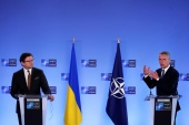 Ukraine's Foreign Minister Dmytro Kuleba (left) flew to Brussels for talks with NATO Secretary-General Jens Stoltenberg (right) a day after Kyiv accused the Kremlin of ignoring its request for talks [Francisco Seco/Pool via Reuters]