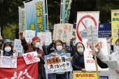 People rally to protest against the Japanese government's decision to discharge contaminated radioactive wastewater from Fukushima Daiichi nuclear power plant into the sea, in front of the Fukushima prefectural government headquarters in Fukushima, April 13, 2021 [Kyodo via Reuters]
