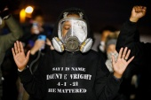 Protesters confront state troopers, National Guard members and other law enforcement officers following the killing of Daunte Wright. [Nick Pfosi/Reuters]
