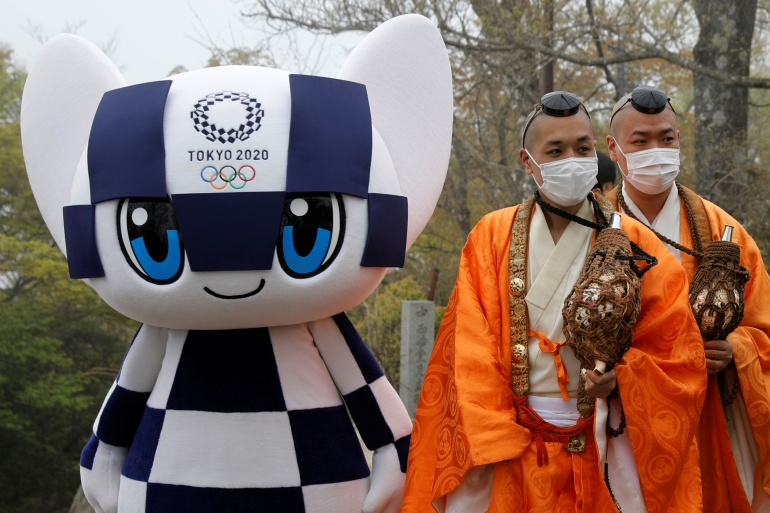 Organisers say they plan a 'safe and secure' Tokyo 2020 Olympics as they mark 100 days to the opening ceremony [Kim Kyung-Hoon/Pool via Reuters]