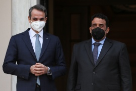Mitsotakis said Athens aimed to reset relations with Libya, which were soured by the Tripoli government's signing a maritime boundary accord in 2019 with Turkey [Costas Baltas/Reuters]