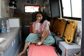 A patient wearing oxygen mask waits inside an ambulance in a queue to enter a COVID-19 hospital in Ahmedabad [Amit Dave/Reuters]