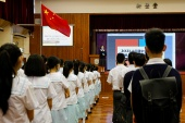 The Chinese national flag is seen during morning assembly, in the run-up to National Security Education Day at a secondary school, in Hong Kong, April 12, 2021 [File: Tyrone Siu/ Reuters]