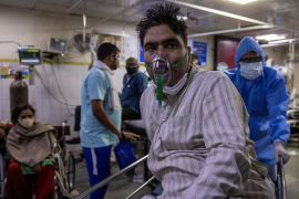A patient suffering from the coronavirus disease (COVID-19) is wheeled from the casualty ward in Lok Nayak Jai Prakash hospital in New Delhi, India, April 15, 2021 (REUTERS/Danish Siddiqui) (Reuters)