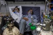 COVID patients at the casualty ward in Lok Nayak Jai Prakash (LNJP) hospital in New Delhi [Danish Siddiqui/Reuters]