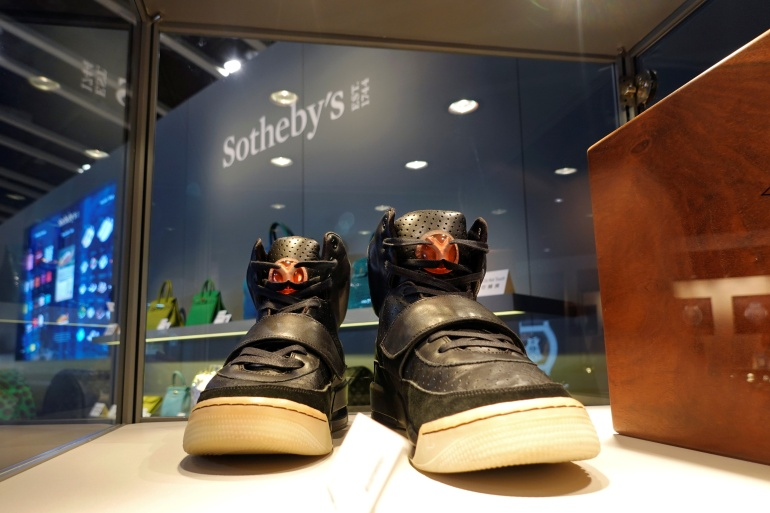 A pair of Nike Air Yeezy 1 prototype sneakers, designed by Kanye West, are displayed at the Hong Kong Convention and Exhibition Centre before going up for private sale at Sotheby's, in Hong Kong [File: Joyce Zhou/Reuters]